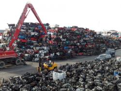 Crushed baled cars